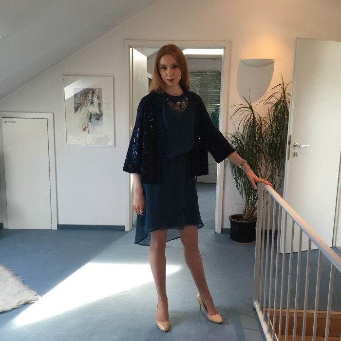 Caroline wears a green chiffon dress from Label Lab with an attached bronze necklace and nude court heels from Dune (yes, we do share things!)  The addition of a turquoise sequined cardigan from Peruna adds a flair to the outfit suitable for evening wear while protecting against the night chill.