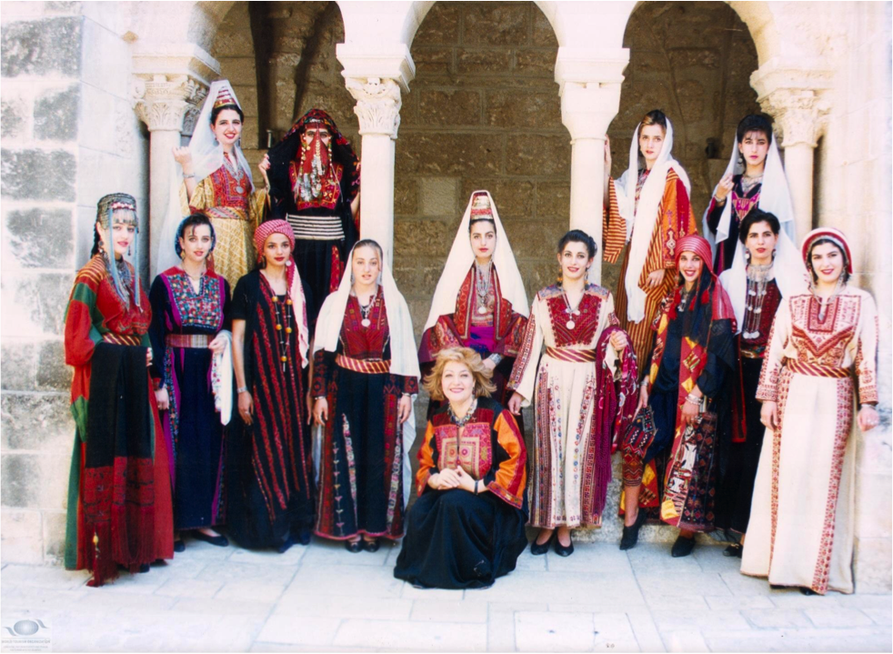 Palestinian women wearing traditional thobes unique to various regions and cities.