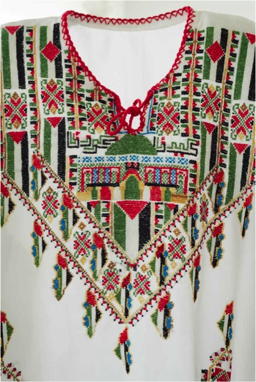 """This ' Intifada Dress ', embroidered with the Palestinian flag, was displayed at the  Palestinian Museum  as part of a 2016 exhibition entitled """"At the Seams: A Political History of Palestinian Embroidery""""."""