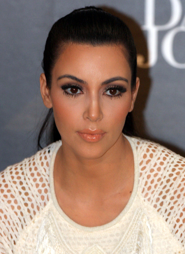 Here is an obligatory picture of Kim Kardashian looking unimpressed. This picture simply DEMANDS a meme about the trials of boring gay sex or awkwardly coming out.