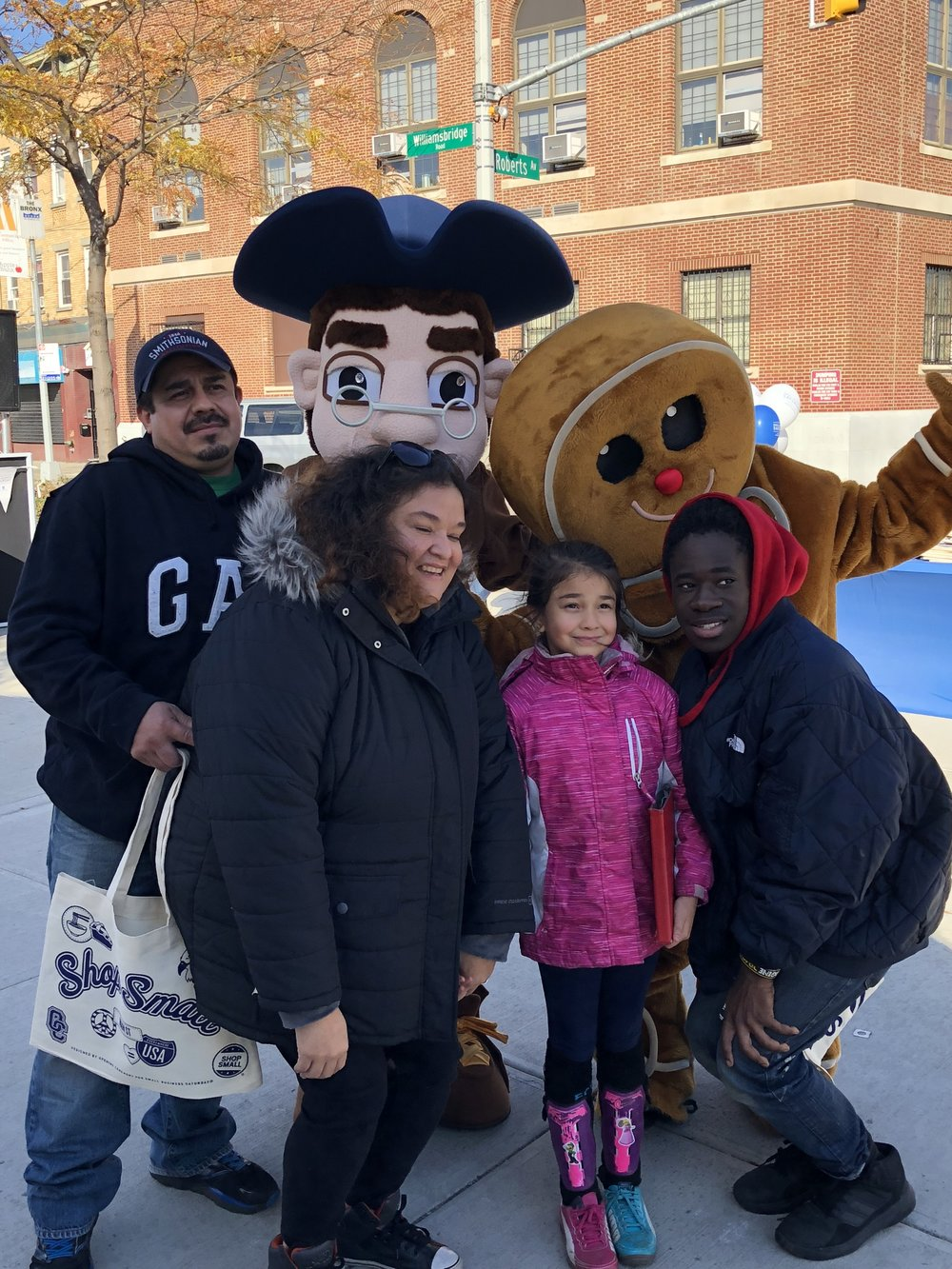 Community members posing with Wes and the Ginger Bread man!