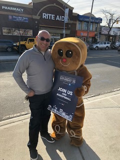 Our Chairman, John Bonizio, posing with the Ginger Bread man in support of Small Business Saturday.