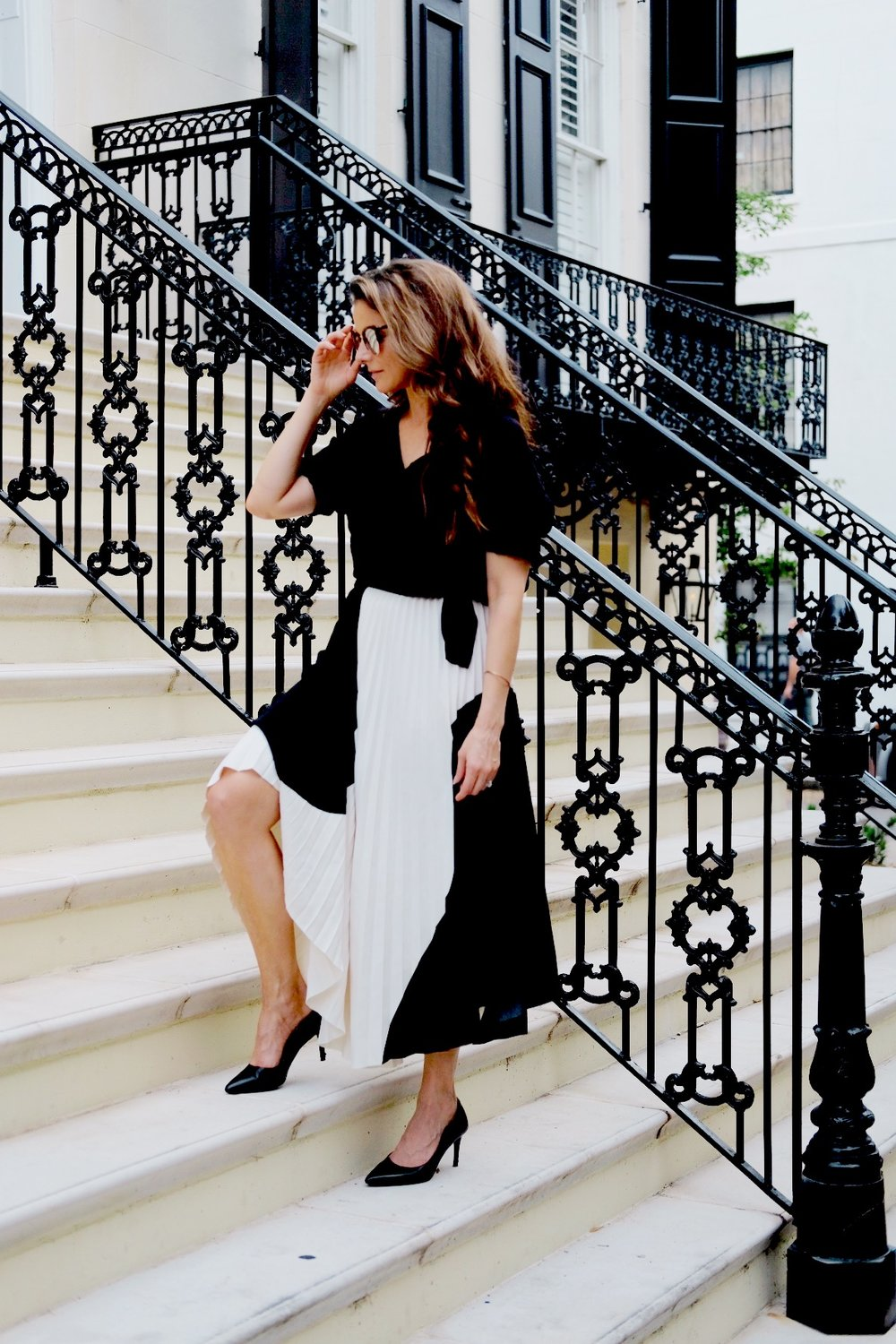 Brenna Lauren Michaels in Black and White Skirt on marble staircase in Savannah, Georgia