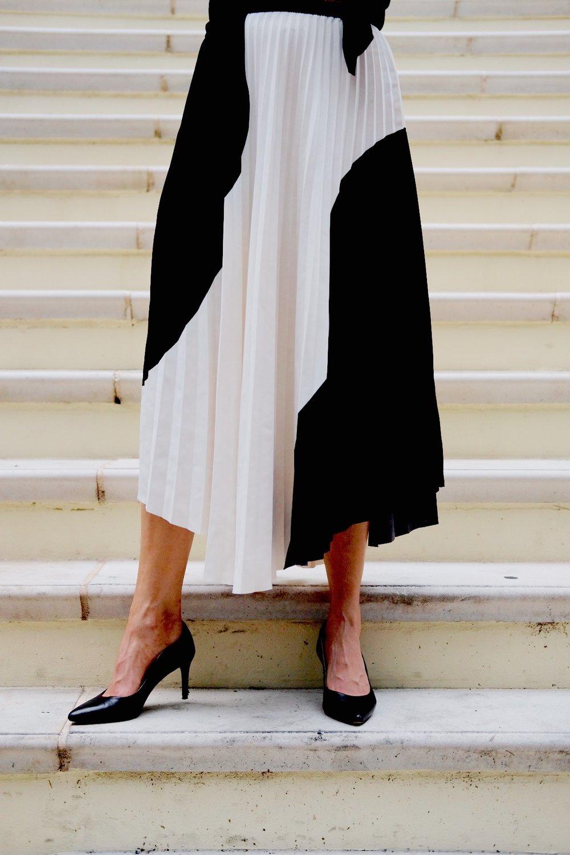 Brenna Lauren in black heels and Black and white skirt