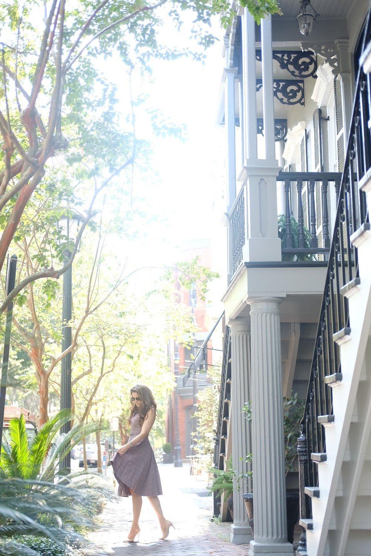 Brenna Lauren on brick sidewalk in Autumn Gal Meets Glam Dress in Savannah, Georgia