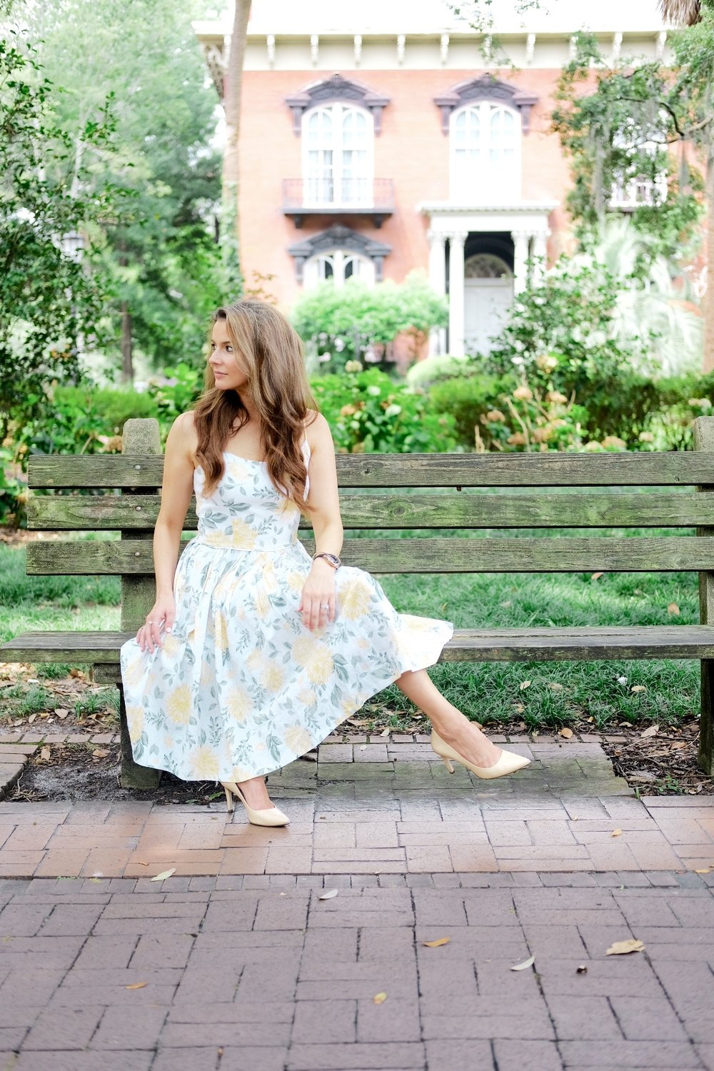 Brenna Lauren Michaels in floral Gal Meets Glam Sundress in Monterey Square Savannah Georgia