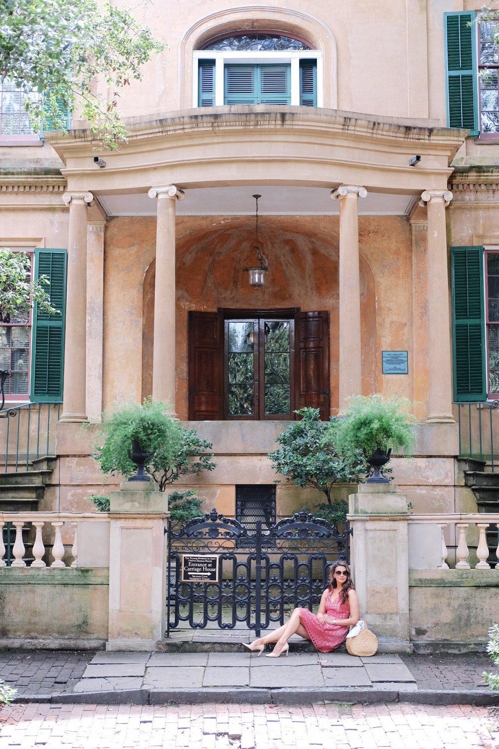 Brenna Michaels in front of the Owens Thomas House in Savannah, Georgia