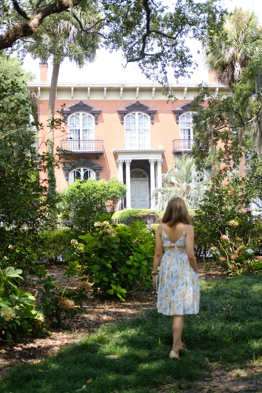 Brenna Michaels in front of the Mercer House in Savannah, Georgia