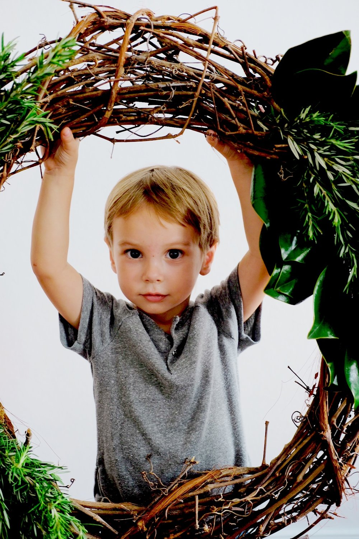 Rhett with Magnolia wreath.jpg