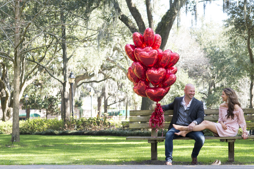 TC and Brenna hold a giant bouquet of heat balloons for Valentines Day