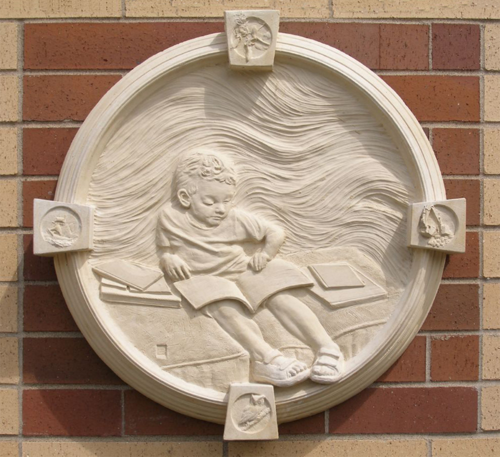 "The Reader I - St. James, MN, cast stone installation, 36"" diameter."
