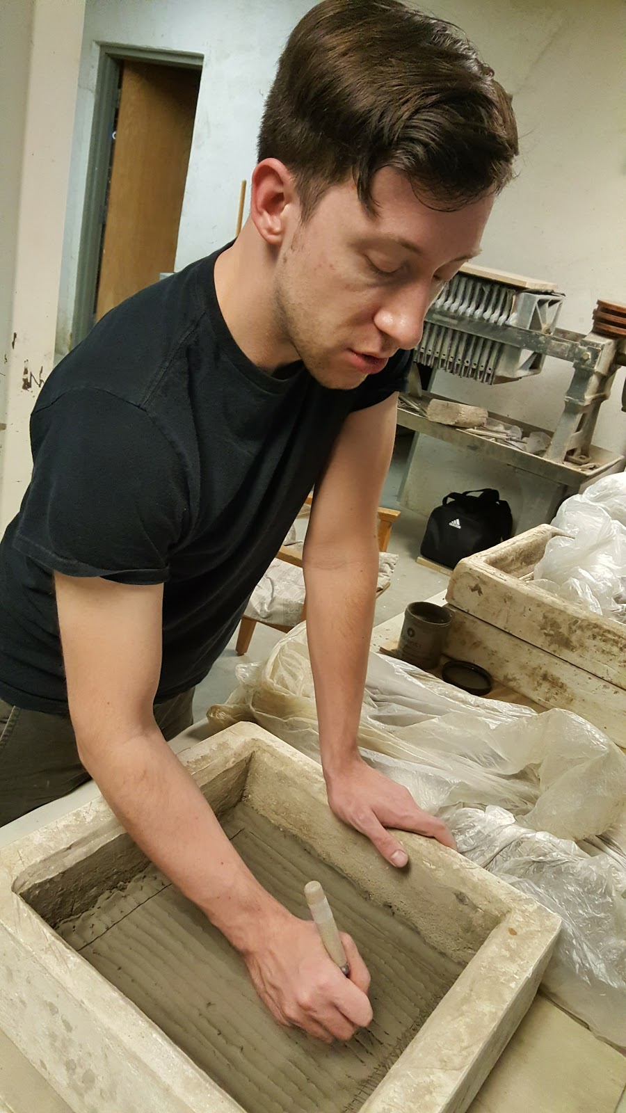 Steven Lemke - Steven Lemke has been an apprentice, exhibition coordinator, and studio manager at the St. John's Pottery. He's returned to do some sculpture work, and he's been super helpful for us newbies!
