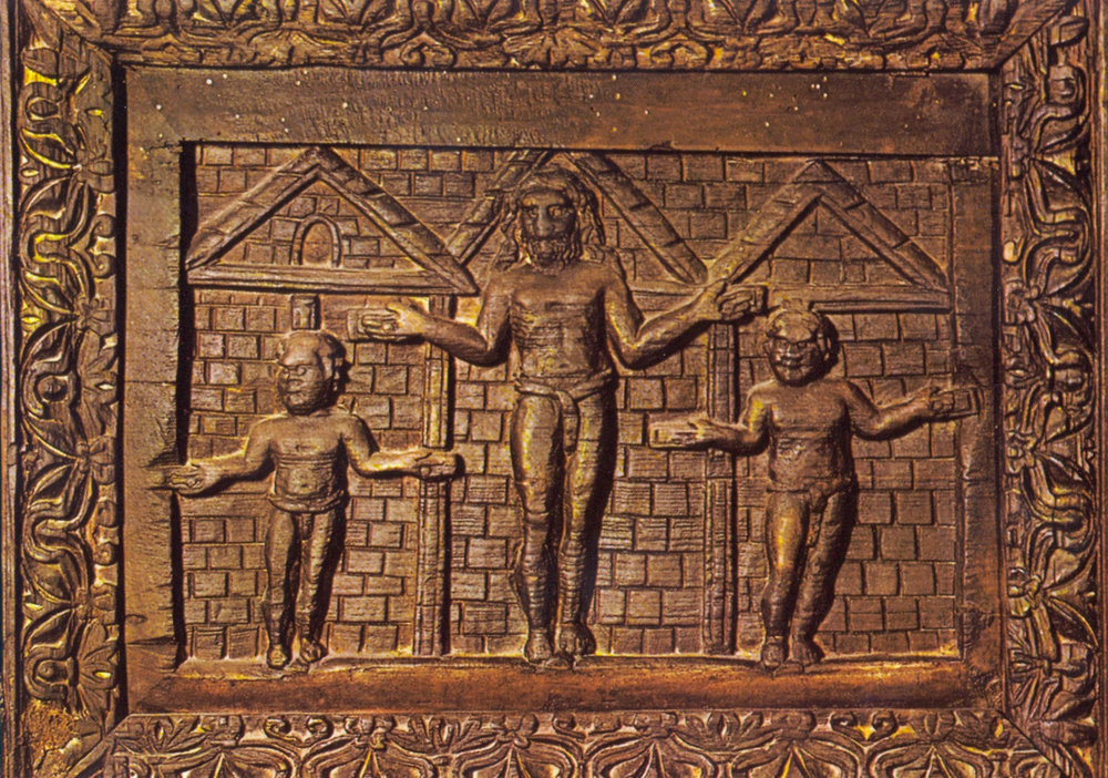 1st Crucifix? - Approx. 425 AD.  Panel on doors of Basilica of Santa Sabina in Rome.