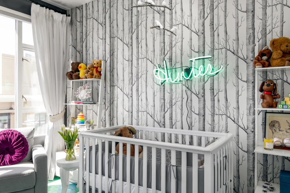 Hunter's name was the inspiration for this design; it had to be special, playful and magical. This is a modern take on a forest theme. The color scheme (blue, green and blue-green) is great for bedrooms because of the calming effects they produce.