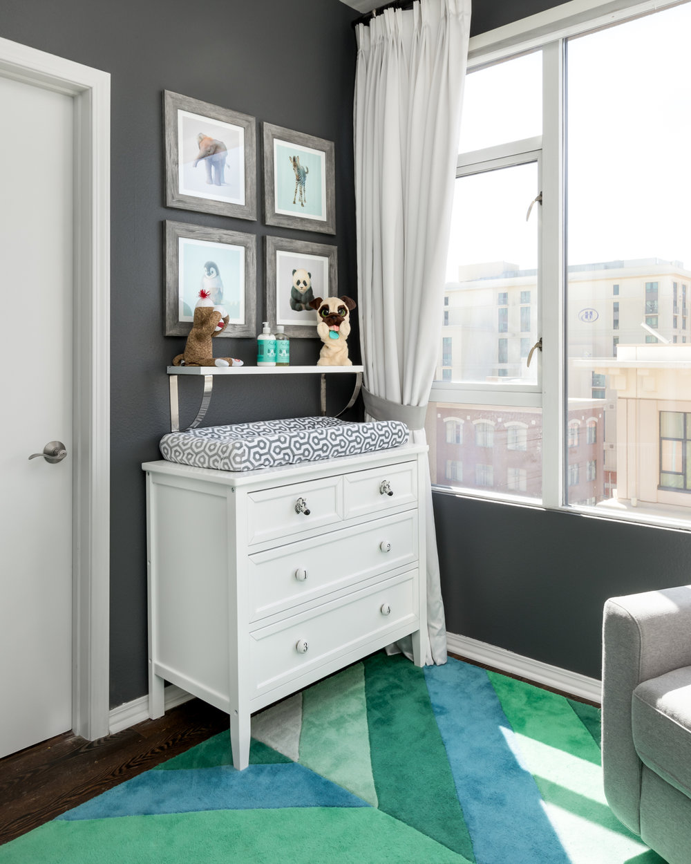 The dresser which doubles as a changing table was updated with zebra and number pulls. Working with a strict budget we paid attention to the little things like changing the hardware on an inexpensive dresser to give it a custom feel without the price tag.