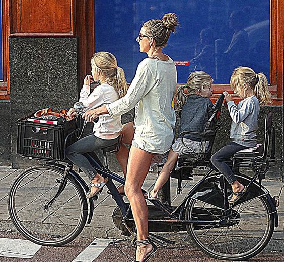 No helmets.  The picture links to an article about Dutch children being some of the happiest children in the world.