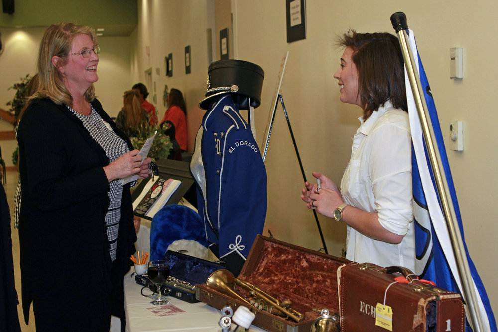 Photo 3_ EDHS Drum Major, Audrey ODonnell, shares the need for replacement musical instruments with a WFED member..jpg