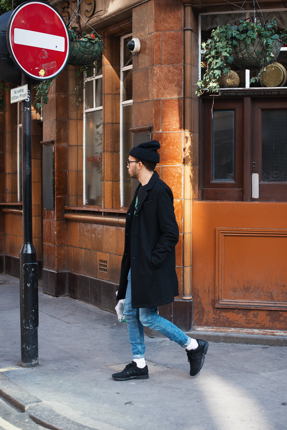 Denim and black.  Similar look:   Nudie Jeans   and   Sandro Wool-Blend Overcoat  .