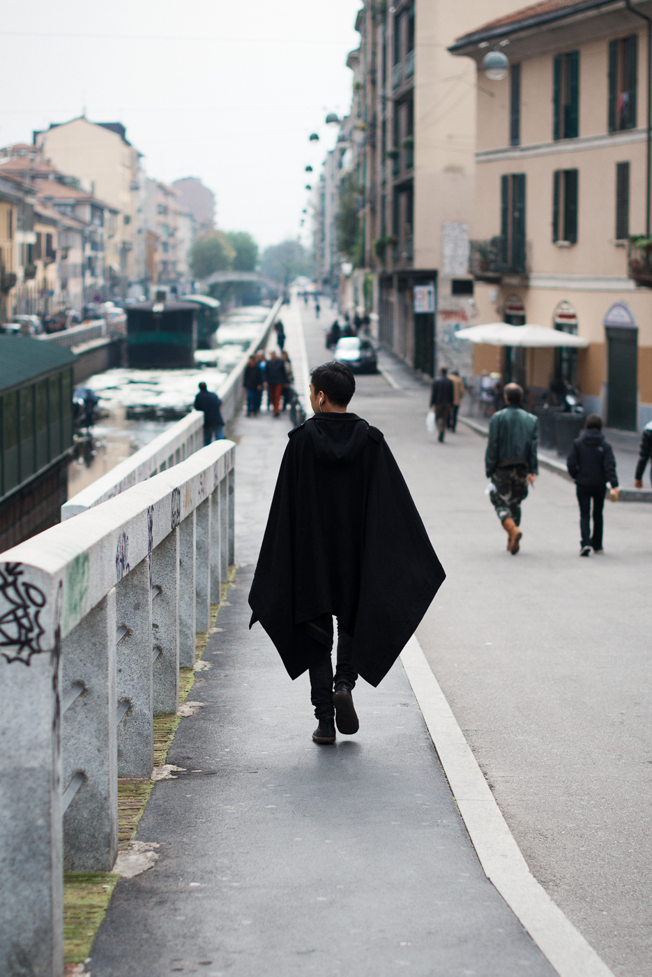 Caped. Similar look: Thamanyah Black Fleece And Angora Ehram Cape.