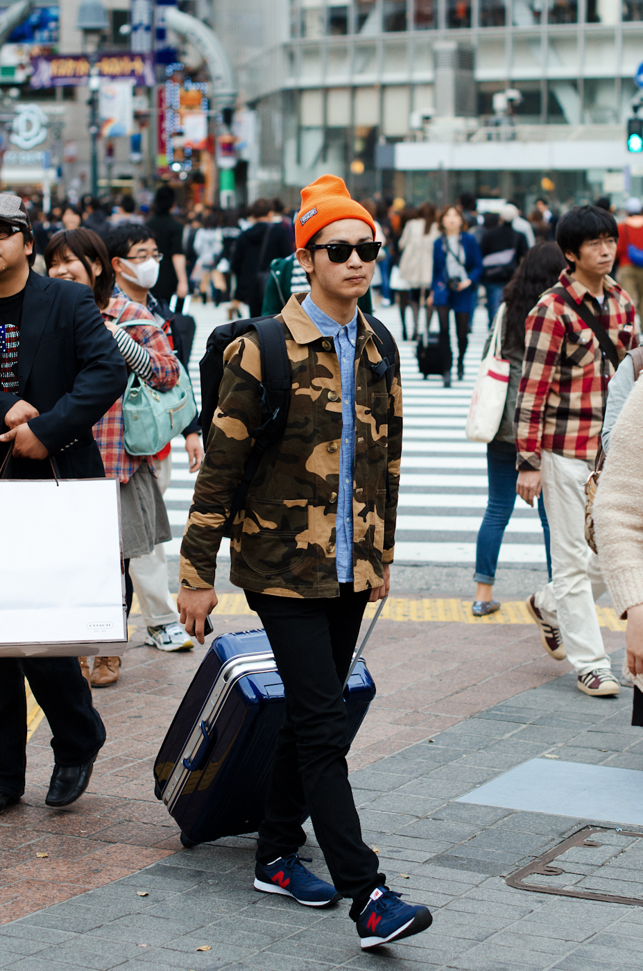 Wearing camo. Similar look: A.P.C. Men's Camo Solider Jacket.