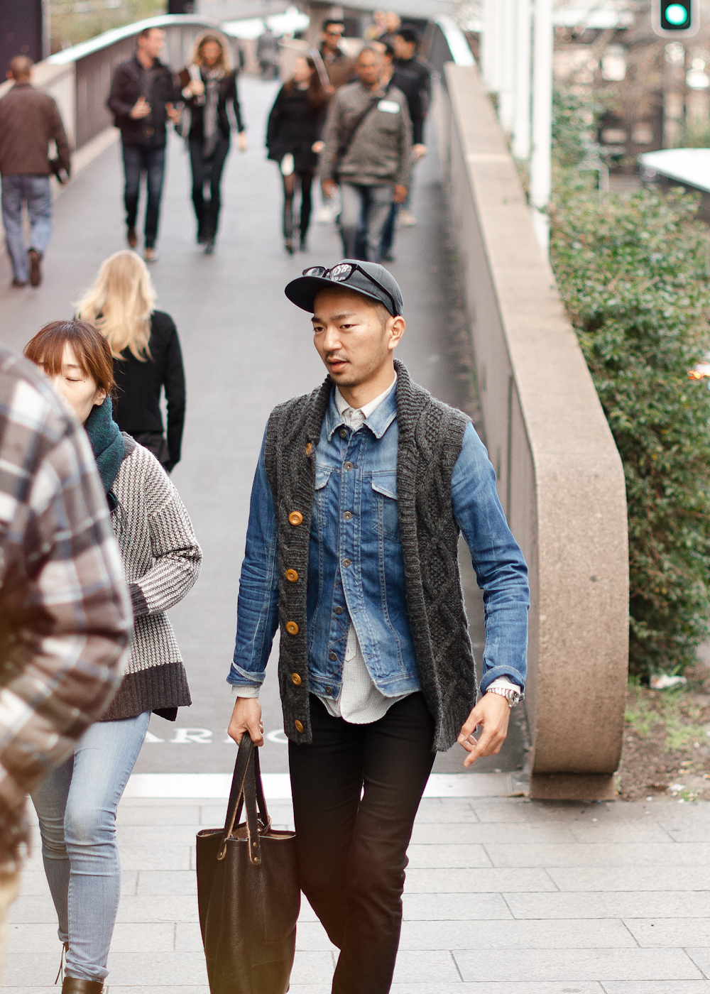 Denim and knits. Similar look: Nonnative Men's Roamer Knit Vest Cardigan.