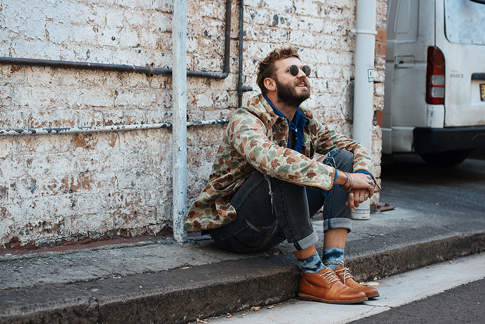 Jules wears the blue bandana, blunt tie and tie-dye socks from his Find Your Magic Collection, available exclusively at The MITT Mrkt. All proceeds from the collection will be made to LYNX's charity partner, I-Manifest.