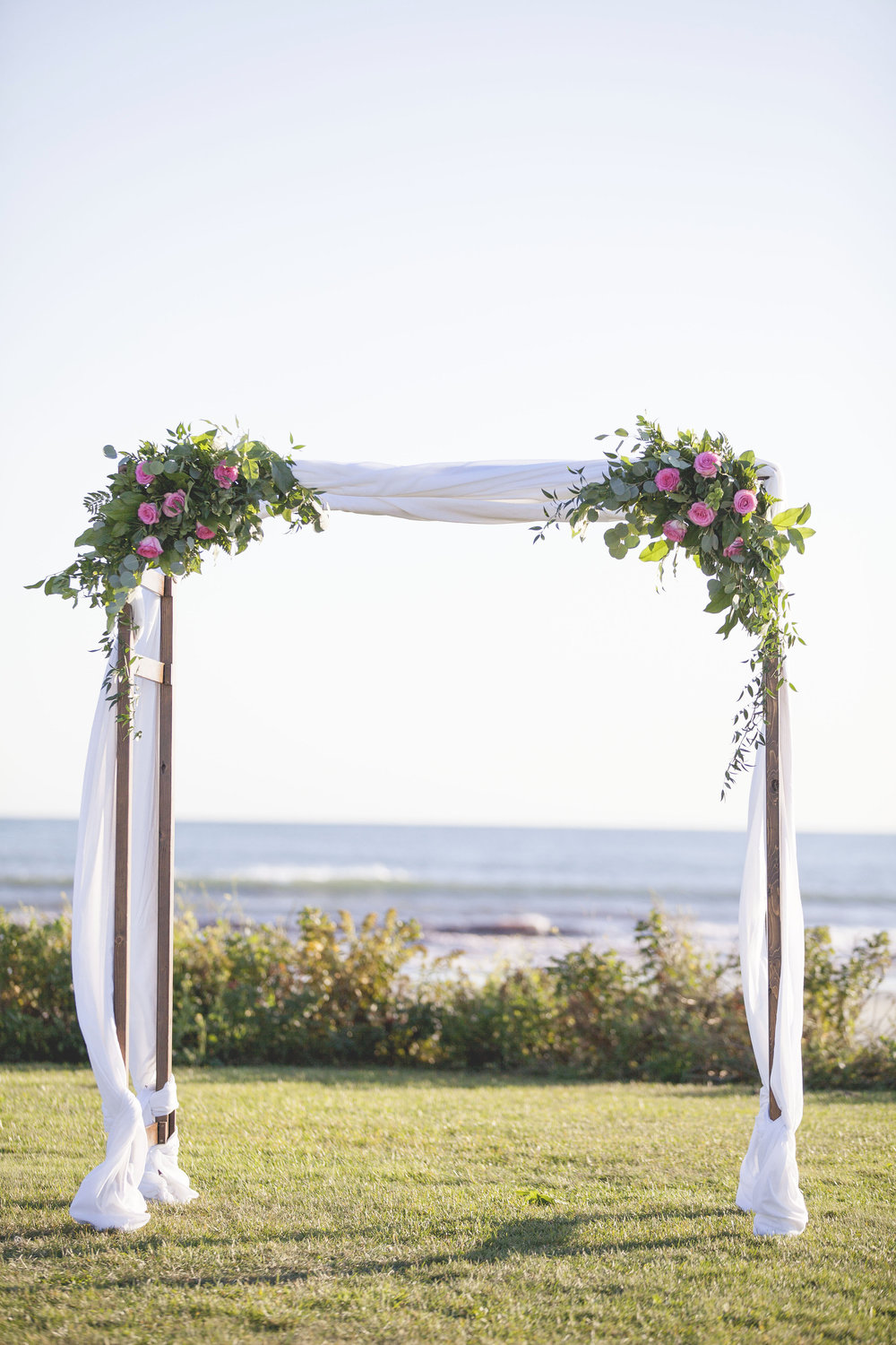Ashley and Chuck | Atlantic Beach Club, Newport RI Event Design: www.champagneandink.com Photo: Joseph Laurin Photography | http://www.joelaurinphotography.com/  #newportri #newportwedding #champagneandink #joelaurin    #bride #groom #pinkandnavy #beachwedding #wedding #weddingdress #weddingaltar #pinkroses #chuppah