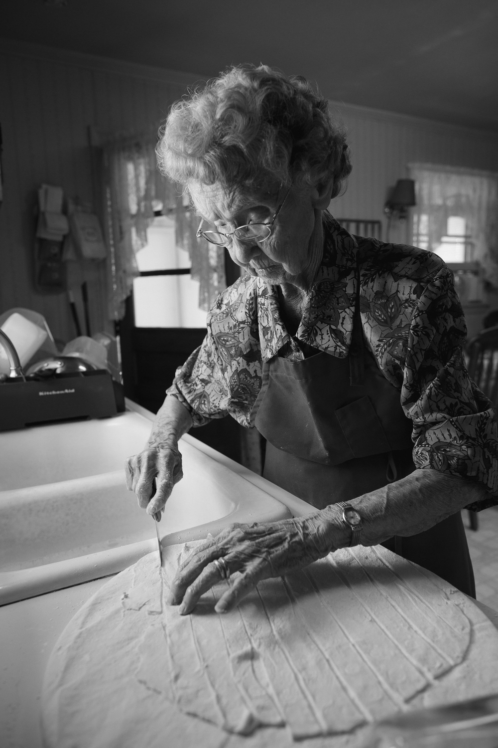 Nonnie, 97,  prepares chicken n'dumplings in her kitchen, which she has done so for 80 years.