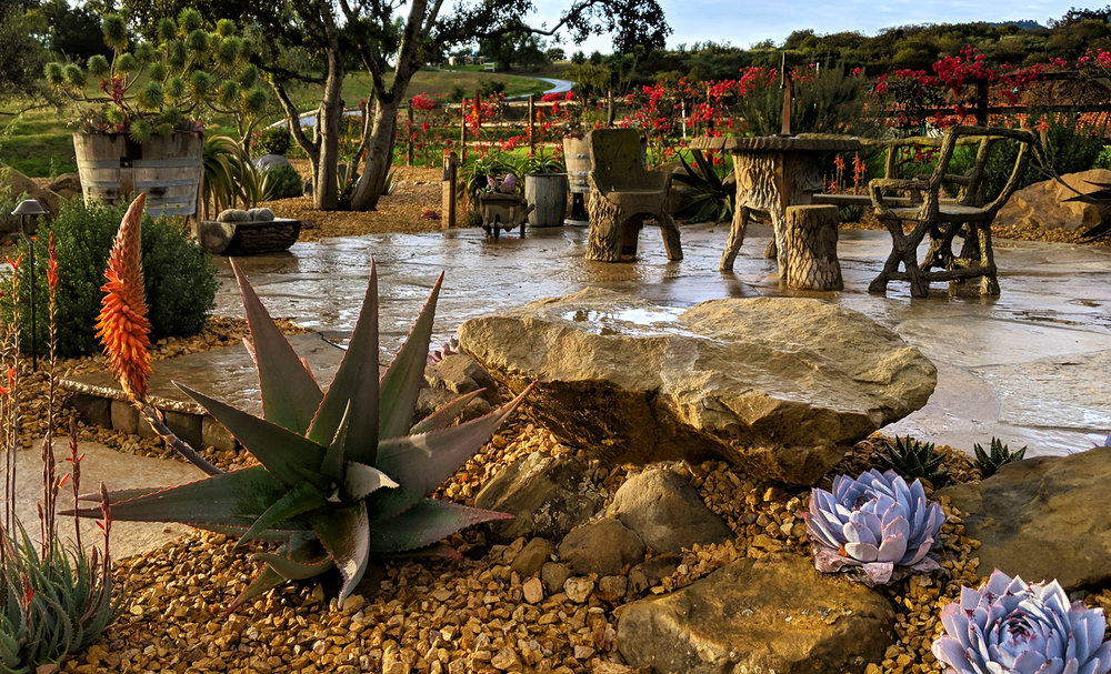 drought tolerant landscape with stone fountain