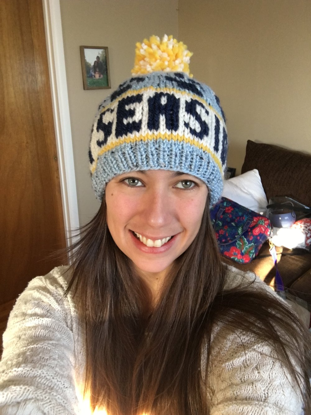 Repping my business with a hat knit by my wonderful mother-in-law!