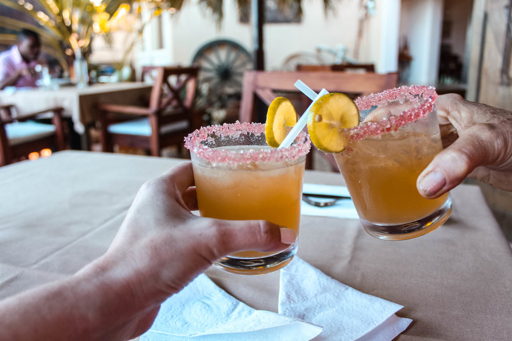 What to drink : Pink rum sours at Auberge Le Picolet are a must, upon arrival in the capital of Cap Haitien
