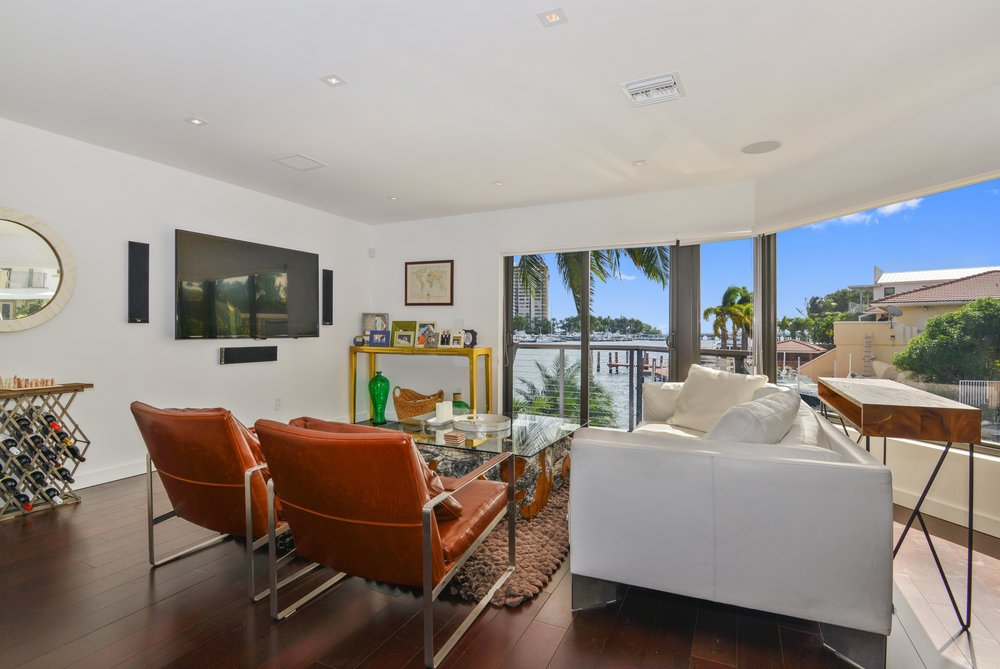 Coconut Grove Townhome Complete with Private Dock Closes at Record Price Per Square Foot