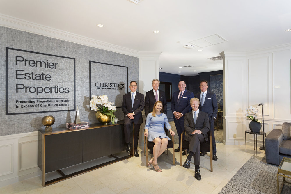 Standing L to R: Gerard Liguori, Jim McCann, Carmen D'Angelo, Joseph Liguori (all with Premier Estate Properties); Sitting L to R: Danielle Austin, Rick Moeser (both with Christie's International Real Estate)