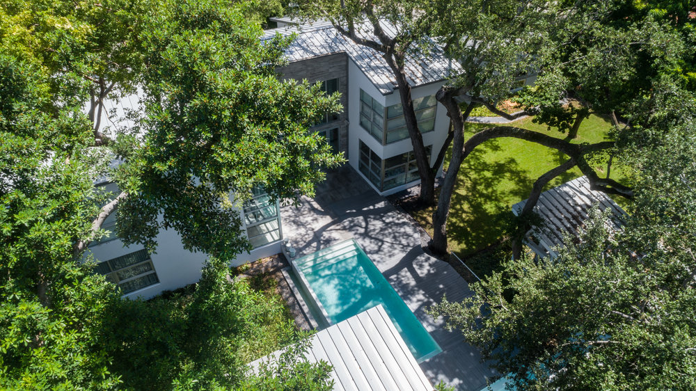 Tour A Stunning Treehouse-Inspired Home Floating Above Lush Greenery In Miami Shores