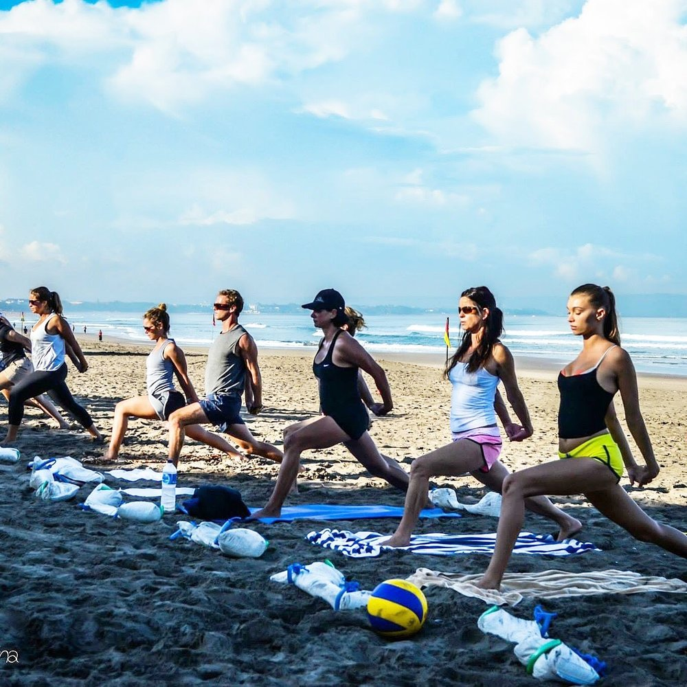 Dynamic warm-up before strength and conditioning on the beach