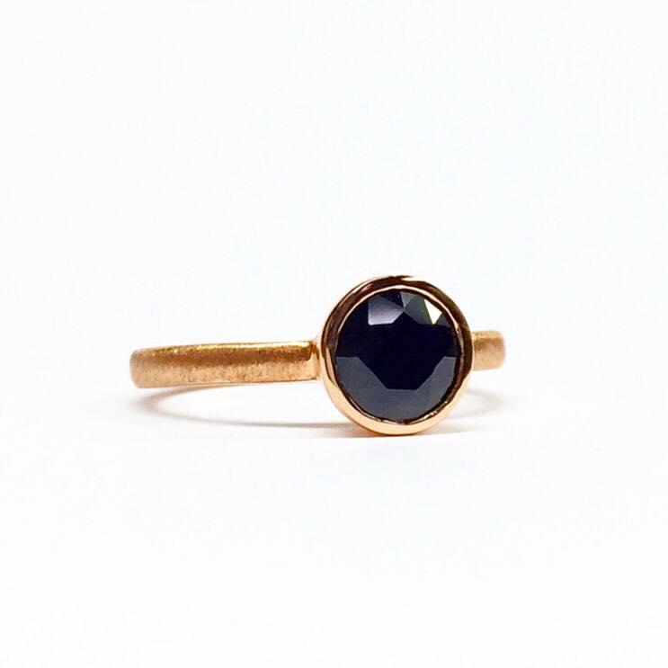 Handmade rose gold ring with bezel-set black Australian sapphire.