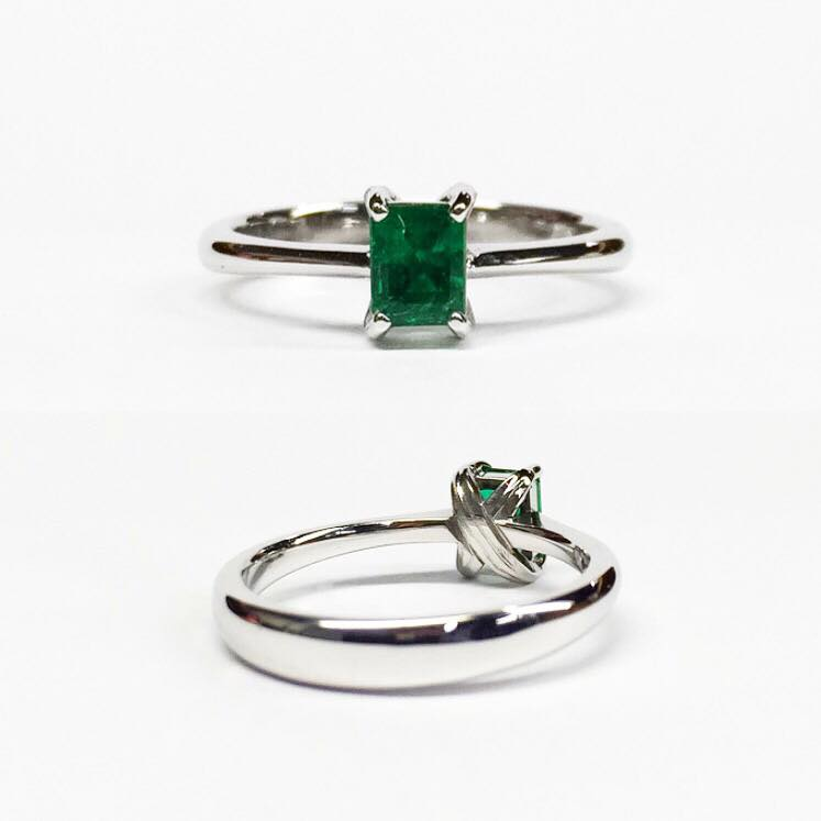 Custom ring for a client who wanted to represent both sides of her heritage, set with an emerald (Columbia) in a eucalyptus leaf setting (Australia).