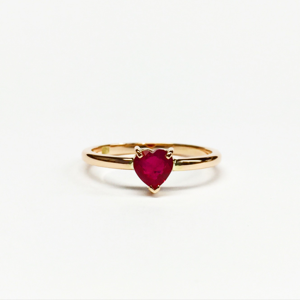 Handmade yellow gold ring set with a heart-shaped ruby.