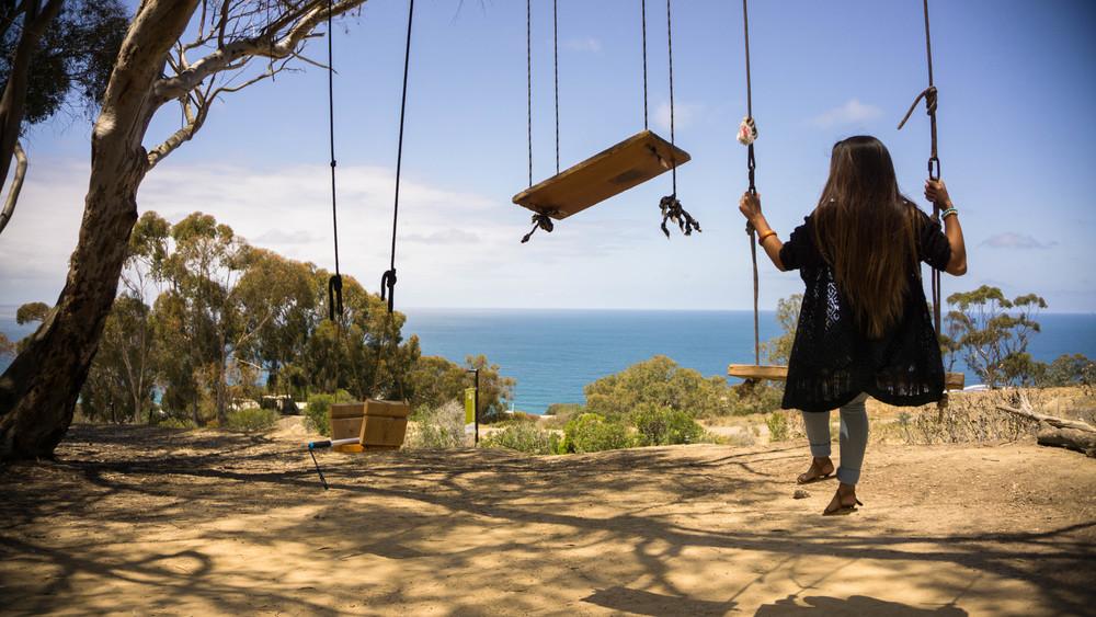 Getting onto the La Jolla Tree Swings