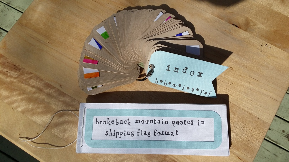 BROKEBACK MOUNTAIN QUOTES IN SHIPPING FLAG FORMAT (BBMISFF) © 2015 Cardstock, linen thread, jump ring; hand-stamped, oil-based pigment ink