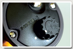 The Penn's threaded knob moves the magnets in and out. I mark the correct setting with white dots