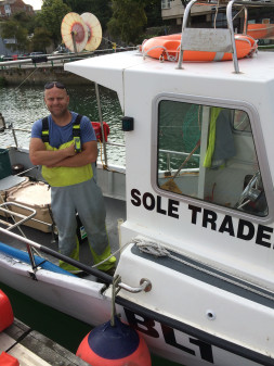 Fisherman Simon Jones on his Fast Worker 19 with his ACR ResQLink Personal Locator Beacon