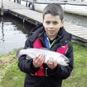 8-year-old Sam Willis with a 2lb rainbow trout caught on April 9, 2018 at Blithfield.