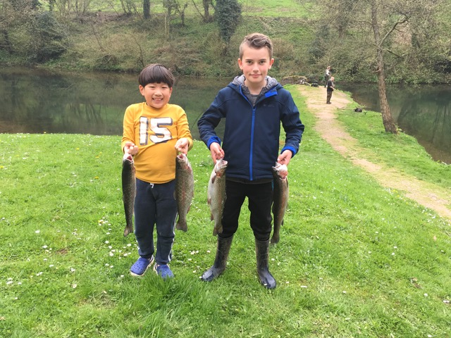 Wilbur Leoviriyakit (7) and Will Brooks (11) with their Bigwell fish.