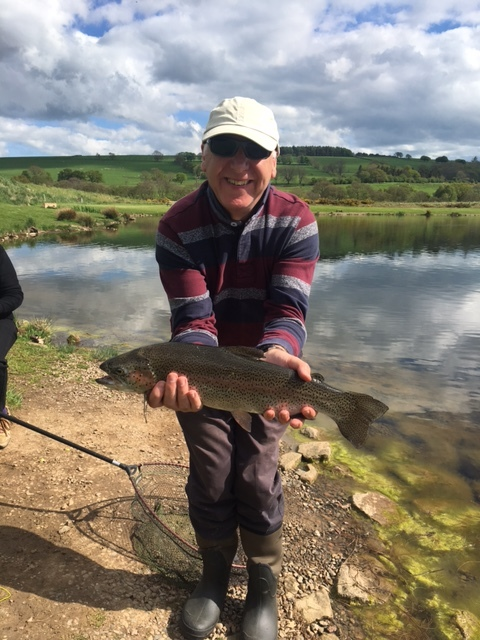 Clive Roper from Leicester was delighted to land his personal best 4lb rainbow on a Black Hopper at Thrunton.