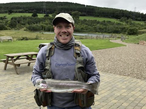 Mathew Lowery from Whitley Bay, with a 4lb Rainbow from Thrunton fishery.