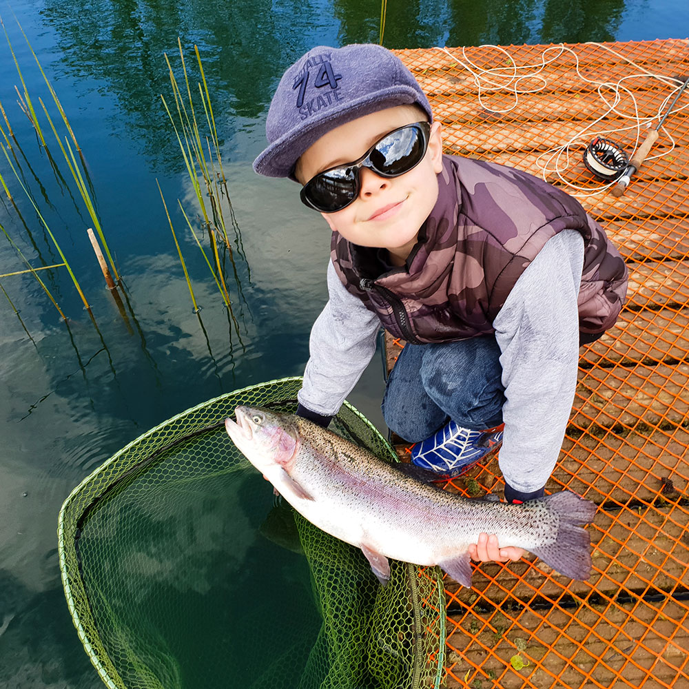 Brandon Porter, age 8, enjoying his local water Mere Beck Trout Fishery