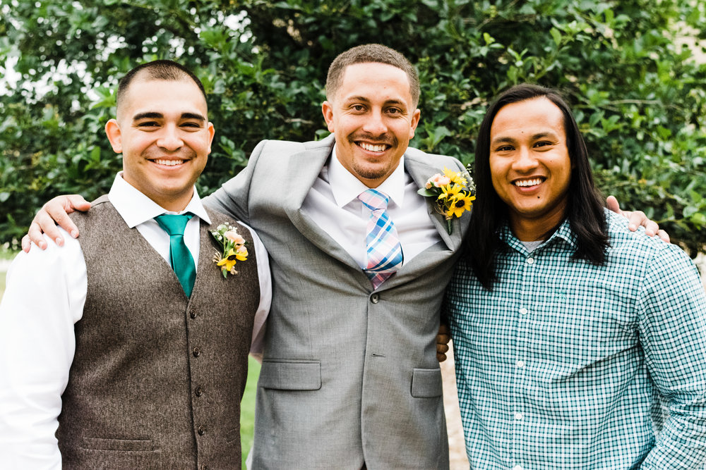 portrait of the groom and two friends at Parker Evangelical Presbyterian Church
