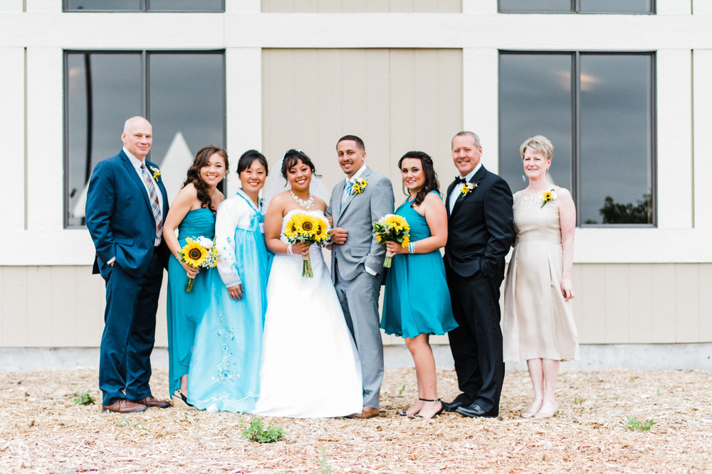 portrait of the bridge and groom and their immediate families at Parker Evangelical Presbyterian Church