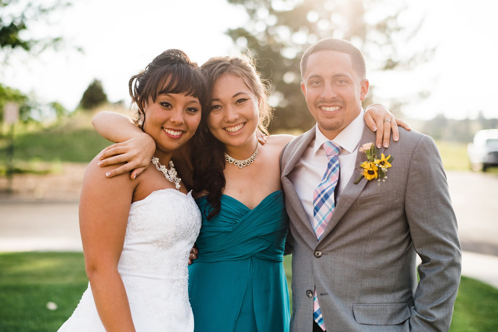 portrait of the bridge and groom with the bride's sister at Parker Evangelical Presbyterian Church